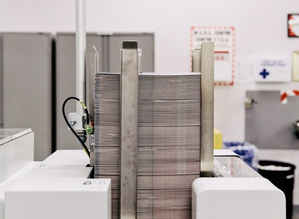 Passports stacked in a machine before being completely assembled